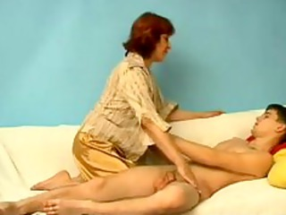 young slim lad with corpulent older russian woman