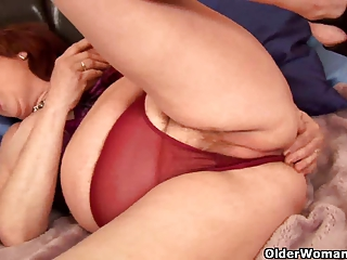 chubby granny probes her old pussy with a fake