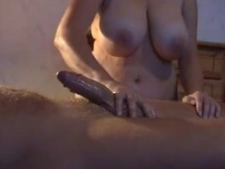 buxom wife gives her fellow a oily cook jerking
