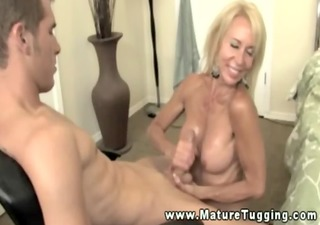 golden-haired cougar jerking off his hard cock