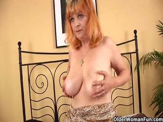 redheaded granny with big titties sucks strapon
