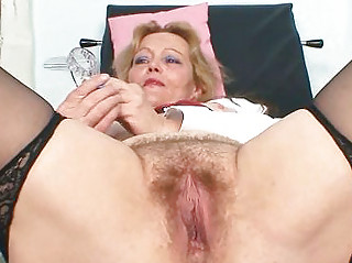 filthy mature lady toys her hirsute pussy with