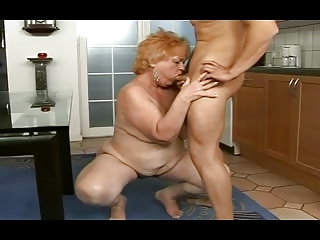 obese granny receives a facial from a guy