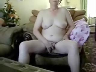 aged lady masturbates in front of cam